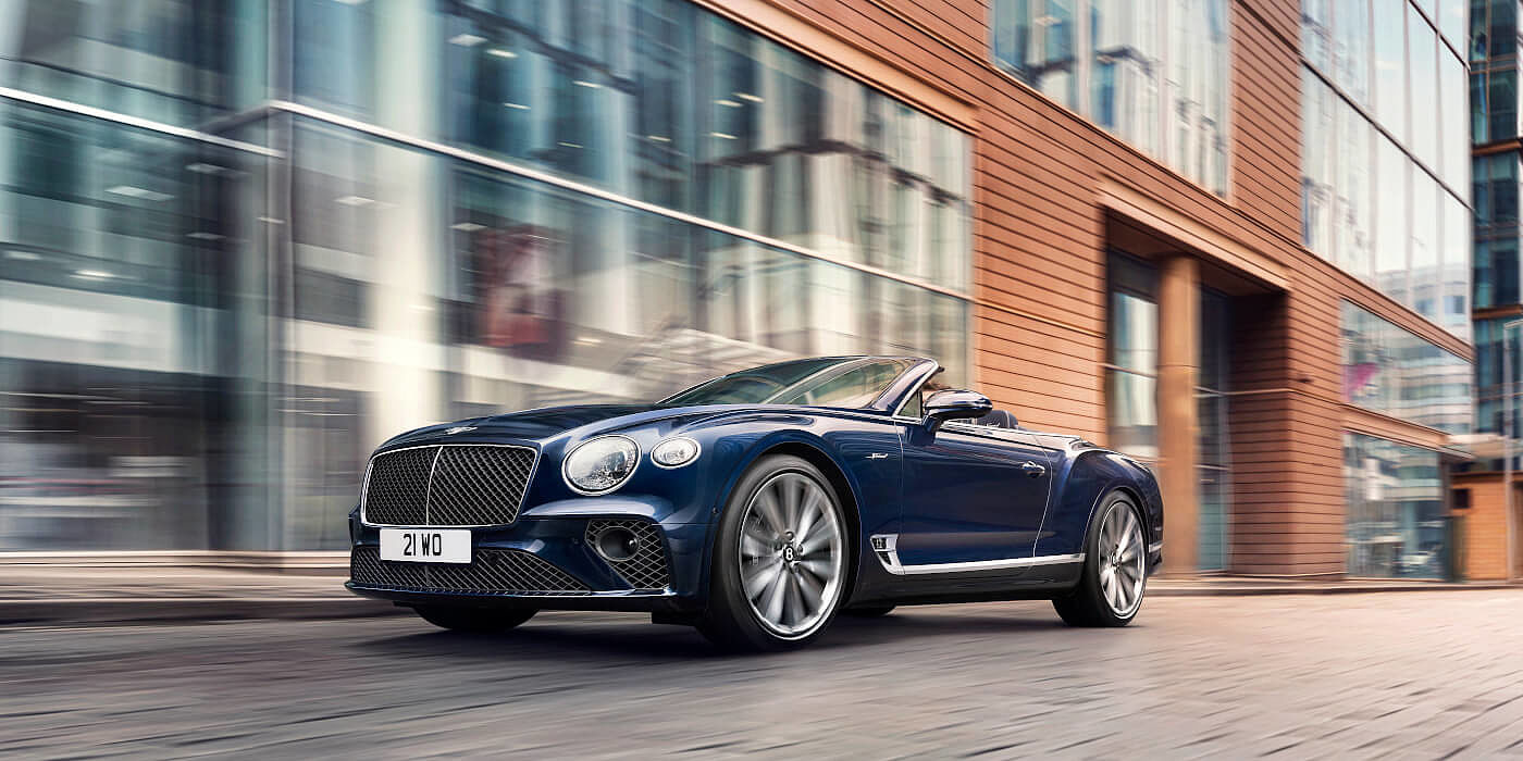 <new-bentley-continental-gt-speed-convertible-in-peacock-blue-paint-driving-in-manchester>
